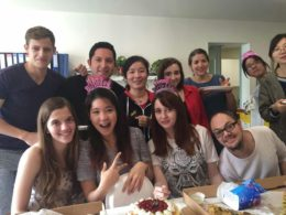 Teachers and students enjoying cake and pizza